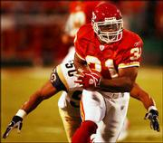 St. Louis linebacker Pisa Tinoisamoa chases down Kansas City running back Priest Holmes (31) in the first half of the Chiefs' 24-7 victory over the Rams. Holmes rushed for 31 yards and a touchdown in the exhibition victory Monday night at Arrowhead Stadium in Kansas City, Mo.