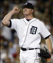 Detroit pitcher Jeremy Bonderman celebrates the final out of his shutout win over the Chicago White Sox. Bonderman struck out 14 in the Tigers' 7-0 victory Monday in Detroit.