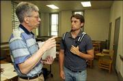GEORGE WILEY, LEFT, A PROFESSOR OF RELIGION AT BAKER UNIVERSITY, visits with Joe Ahmadian, a Dallas sophomore, on the first day of classes. Baker is launching a new preministerial program to prepare undergraduates for church leadership.