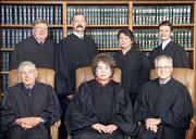 Justices of the Kansas Supreme Court are, back row from left, Robert Gernon, Lawton Nuss, Marla Luckert and Carol Beier, and front row, from left, Donald Allegrucci, Chief Justice Kay McFarland and Robert Davis.
