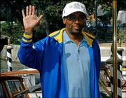 "U.S. movie director Spike Lee waves to fans a day before the opening of the 61st Venice International Film Festival, in Venice, northern Italy. Lee has an out-of-competition movie, ""She Hate Me,"" at the festival and is also part of the nine-person jury. The 11-day show begins today."