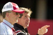 Nebraska coach bill callahan, right, and chancellor Harvey Perlamn watch the Cornhuskers practice. Callahan will make his debut as the Huskers' coach today against Western Illinois in Lincoln, Neb.