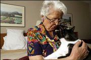 Evelyn Mishler's home in Punta Gorda, Fla., was destroyed by Hurricane Charley. She and her cat, Happy, are currently living at a Lawrence hotel, waiting for what is left of her possessions to arrive in Lawrence before she moves into a new home.