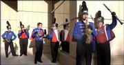 A half-dozen members of Kansas University's marching band show off various versions of their new uniforms, which will make their debut prior to today's KU-Tulsa football game at Memorial Stadium. The musicians are, from left: Jennifer Richard, Topeka sophomore; Karen Albertin, Lake Ozark, Mo., junior; Evan Billings, Shawnee Mission junior; Kim Studstill, O'Fallon, Mo., senior; Tim Spencer, Derby senior; and Meredith Allen, Shawnee sophomore.