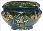 This Jardiniere is attributed to Frederick Rhead. It is marked with the Avon Pottery mark and sold for $880.