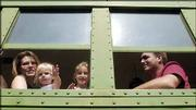 From left, Aimee McLendon, Garden City, daughters Ruby, 18 months, and Annabelle, 5, and husband Jason McLendon are framed by the windows of their rail car as they depart Baldwin on the Midland Railroad.