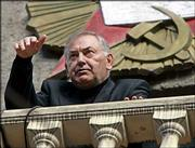 President of North Ossetia Alexander Dzasokhov speaks from a balcony of a regional administration headquarters during a meeting in the region's capital, Vladikavkaz. Dzasokhov said that the regional government would step down within two days, the first sign of officials being punished for last week's siege.