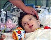 Azamat Mukagov, 20 months old, from Beslan, lies in a hospital bed in a children's hospital in Moscow. Eight victims of the school hostage crisis were receiving treatment at the hospital for burns and gunshot wounds.