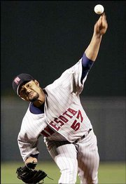 Minnesota twins starter Johan Santana fires a pitch to Baltimore's Miguel Tejada. Santana blanked the Orioles, 9-0, for his 10th straight victory Wednesday in Baltimore.