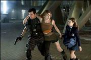 "Oded Fehr, left, Milla Jovovich and Sophie Vavasseur star in ""Resident Evil: Apocalypse."""