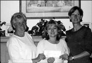 From left Mary Lynn Stewart, of the Lawrence Flower Club; Diana Frederick, of the Audio-Reader Network; and Leann Johnson, of Prairie Acres Garden Club show off a $2,000 check for a Historic Gardens Project Grant sponsored by the Principal Financial Group. Members of the Lawrence Flower Club and Prairie Acres Garden Club are working on the grant to enhance and expand the Audio-Reader Sensory Garden.