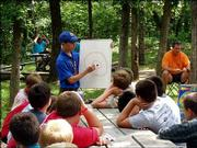 Tyler Thomas, of Boy Scout Troop 62, teaches a geology class at Theodore Naish Scout Reservation near Bonner Springs. Tyler worked this summer in the Nature Lodge at the reservation. He taught classes to three sessions of Boy Scouts and 10 sessions of Webelos.