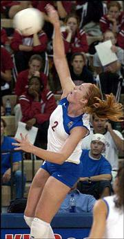 Kansas University's Ashley Michaels drives home a volley by Rhode Island. The Jayhawks defeated the Rams, 30-23, 30-24, 30-21, in the Holiday Inn/Jayhawk Classic on Friday at Horejsi Center.