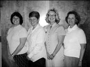 The newly-elected officers of the Twilight Chapter of American Business Women's Assn. are, from left, Shari Stamer, secretary; Susie Bartlett, treasurer; Helen Cox, vice president; and Connie Ingle, president. They were pictured Aug. 16 during a business meeting at the American Legion.