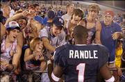 Kansas' John Randle, who rushed for 104 yards and scored three touchdowns, celebrates with fans.
