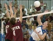 Kansas University senior middle blocker Ashley Michaels, right, sends a spike past Denver University players Lisa Hunter, left, and Kim Muller. KU won, 3-0, claiming the Jayhawk Classic crown on Saturday at Horejsi Center.