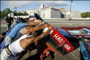 Cubans remove boats from the water in Havana to prevent possible damage from Hurricane Ivan. The death toll Saturday from Ivan as it headed from Jamaica toward Cuba was at least 56.