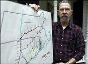 Historian Bob Wilder is shown with a map he created showing the Post Road markers between Boston and New York. Wilder has researched the road for 40 years.