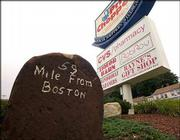 One of the old Post Road mile markers dating from the 1700s now stands in what is a shopping plaza in Spencer, Mass., 59 miles from Boston. Benjamin Franklin's milestones still mark the way on the Boston Post Road, which winds its way though the nation's history with a tale at every turn.