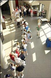 An early morning formed inside the Lied Center Monday as people waited for tickets to the Marine Band performance.