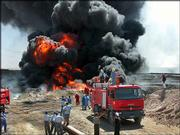 Firefighters try to contain an oil pipeline fire after an attack by insurgents 155 miles north of Baghdad, Iraq. The attack Tuesday set off a chain reaction in power generation systems that left the entire country without power, on a day that other militant attacks left more than 50 Iraqis dead.