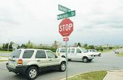 Drivers try to avoid each other at the intersection of Wakarusa Drive and Harvard Road. The city says the intersection, shown at noon Friday, is one of the worst in town and is on a priority list to have improvements done.