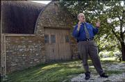 Gregory Thomas, chairman of Kansas University's department of design, plans to make the department more business-oriented. Thomas was pictured Tuesday at the Chamney Barn on KU's west campus. Thomas hopes the barn will become converted into a design research laboratory.