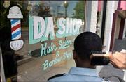Since its opening in 1999, Da Shop has grown beyond its station as a barber shop and salon. It's become a gathering place for Lawrence's black community.