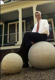 Brad Kemp has placed two large concrete spheres in his landscape in East Lawrence.