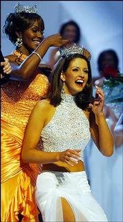 Former Miss America Ericka Dunlap, left, crowns Miss Alabama Deidre Downs as Miss America 2005, during the Miss America Competition at the Atlantic City, N.J., Boardwalk Convention Hall.