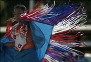 Krysallin Ahtone, 12, dances during the grand entrance at a powwow marking Haskell Indian Nations University's 120th birthday celebration. The festivities took place Saturday afternoon.