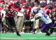 Texas Tech's Danny Amendola (20) returns a kick against TCU's Brian Bonner. Amendola set up a touchdown with a 52-yard return, and the Red Raiders won, 70-35, Saturday in Lubbock, Texas.