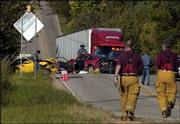 Emergency crews work the scene of a head-on wreck west of Lawrence on U.S. Highway 40, west of its interchange with the South Lawrence Trafficway. Roger A. Thomas Jr., 22, of Lawrence, was lifted from the scene by air ambulance. Joseph M. Hall, 22, of Topeka, was taken by ambulance to Lawrence Memorial Hospital and later discharged.
