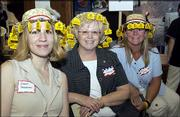 From left are Amber Treguboff, Sue Simmons and Amy Wilson. They represented Stephens Real Estate at the United Way of Douglas County 2004-2005 Campaign Kickoff on Sept. 15 at the Dole Institute of Politics.