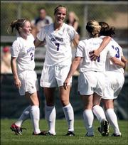 Kansas University soccer players, from left, Nicole Cauzillo, Rachel Gilfillan, Caroline Smith and Jessica Kilpatrick celebrate Gilfillan's second-half goal. The Jayhawks defeated Colorado, 2-1, Sunday at Jayhawk Soccer Complex.