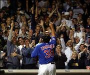 Chicago Cubs fans give starting pitcher Carlos Zambrano a standing ovation as he leaves the game. He allowed one run on five hits in 61/3 innings, and the Cubs provided the offense in a 12-5 drubbing of Cincinnati on Monday in Chicago.