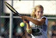 Free State High's Andrea Koch returns a shot during her No. 1 doubles match against Lawrence High. Koch and Jamie McGovern fell to Lawrence High's Katie Robertson and Shannon Wanna, but the Firebirds slipped past LHS, 5-4, in the intracity dual Monday at FSHS.