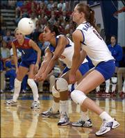 Kansas University's Josi Lima receives a serve from Nebraska while teammates Jill Dorsey, left, and Paula Caten stand poised for a play. The No. 24 Jayhawks lost to the seventh-ranked Cornhuskers, 3-0, Wednesday at Horesji Center.