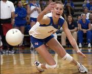 Kansas University's Paula Caten dives for a ball, but can't come up with it during KU's volleyball loss to Nebraska. The seventh-ranked Cornhuskers hammered the No. 24 Jayhawks, 30-13, 30-14, 30-24, Wednesday at Horejsi Center.