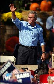 President Bush greets the crowd in Allentown, Pa., the day after his first debate with Democratic presidential candidate John Kerry.