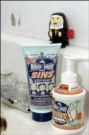 "Many pop-culture novelties spoof religion or religious symbols. ""Nunzilla"" (left) is a windup toy, walks and spits sparks. ""Wash Away Your Sins"" body wash (below) contains frankincense and myrrh and offers ""in-the-shower cleansing power"" to ""liars, cheaters & wrong-doers."""