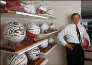 Crown Chevrolet owner Miles Schnaer supplies some of the cars to the Kansas University Athletic Corp. Schnaer is pictured on Friday with his collection of signed KU basketballs, footballs and baseballs.