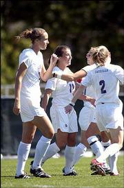 KU's Jessica Kilpatrick, second from left, is congratulated by teammates after she scored in the first half.