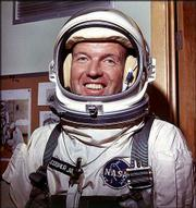 Astronaut Gordon Cooper is shown in his space suit in this July 1965 file photo. Cooper, one of the original Mercury astronauts who were pioneers in human space exploration, died Monday at age 77.