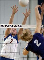 Kansas University senior Ashley Michaels, left, blocks a shot by Kansas State's Joy Hamlin in the second game. The 16th-ranked Wildcats survived a scare from the No. 19 Jayhawks, escaping with a 3-2 victory Wednesday night at Horejsi Center.