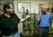 Israeli scientists Aaron Ciechanover, left, and Avram Hershko, both of Israel, speak to journalists in Haifa. The two and Irwin Rose, of the United States, won the 2004 Nobel Chemistry Prize Wednesday.