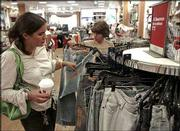 Hannah Poole, left, and Amanda Schlitzer shop at an American Eagle store in suburban Philadelphia. American Eagle Outfitters Inc. reported Wednesday that September sales had a 22.7 percent increase, above analysts' predictions. But most retailers reported lukewarm sales for the traditional back-to-school month. Poole and Schlitzer are shown in this Sept. 1 file photo.