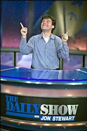 "Stewart Bailey, co-executive producer of ""The Daily Show,"" is pictured on the set of the Comedy Central series. Bailey, a 1989 KU graduate, is a Topeka native."