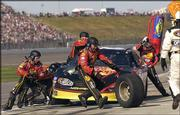 Tony Stewart's pit crew works on a stop during the NASCAR Busch Series Mr. Goodcents 300. Joe Nemechek won the race Saturday at Kansas Speedway in Kansas City, Kan.