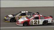 NASCAR Nextel Cup driver Joe Nemechek, top, edges Ricky Rudd on the final lap to win the Banquet 400. Nemechek, who also won Saturday's Busch Series race at Kansas Speedway, won again at the track Sunday in Kansas City, Kan.